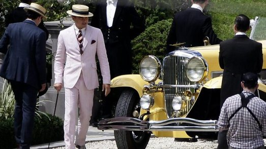 Leonardo DiCaprio as Jay Gatsby Looking Sharp as He Walks Past a Duesenberg