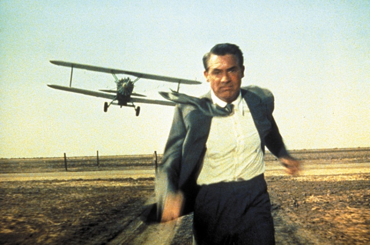 Cary Grant in a Suit Jacket Out-running a Plane